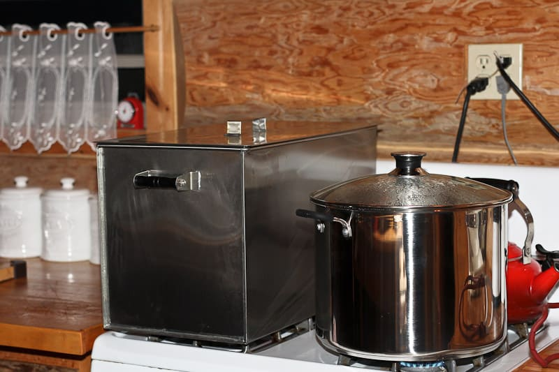 The Amish made water bath canner holds 15 quart jars or 27 pint jars